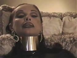 Brunette - posture collar, heavy makeup + smoking