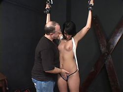 Dark?haired hottie, bound & getting ready for a BDSM session