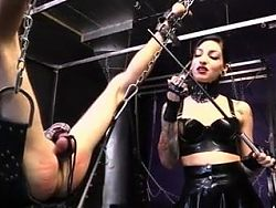 Cybil Troy gets a caning in chastity