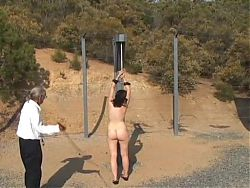 Restrained and Whipped Outdoors