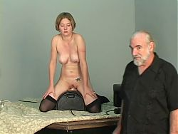 Short-haired b-cup blonde lowers her pussy onto mechanical dildo