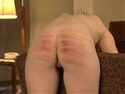 Caned naked over a chair