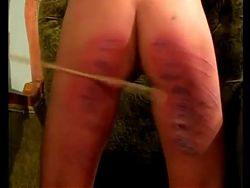 A skinny young lady receives a caning