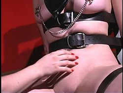 Slut in mask has her pussy lips clamped