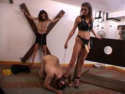 Dominatrix punishes slaves